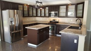 Kitchen Renovation Mississauga finished project with new cabinets and kitchen center island with granite countertop
